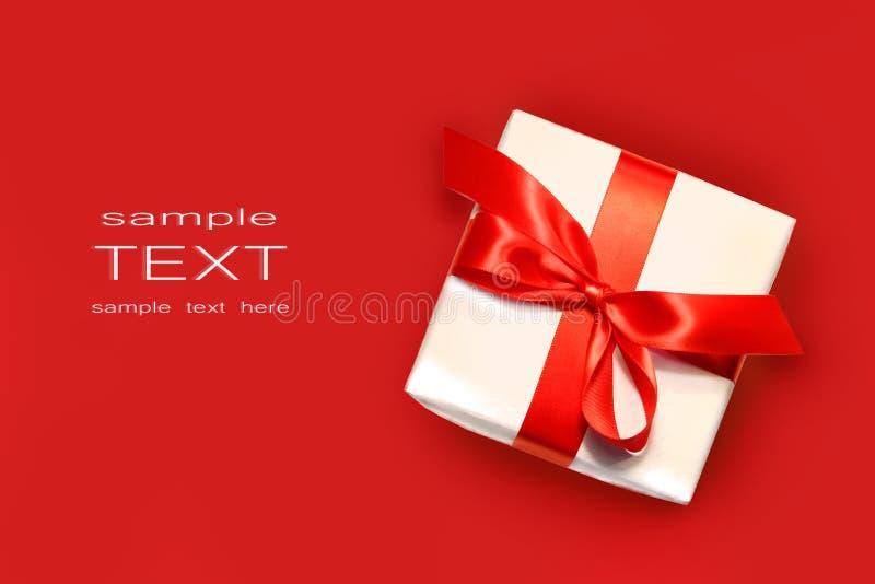 查出的礼品一点红色白色 库存照片