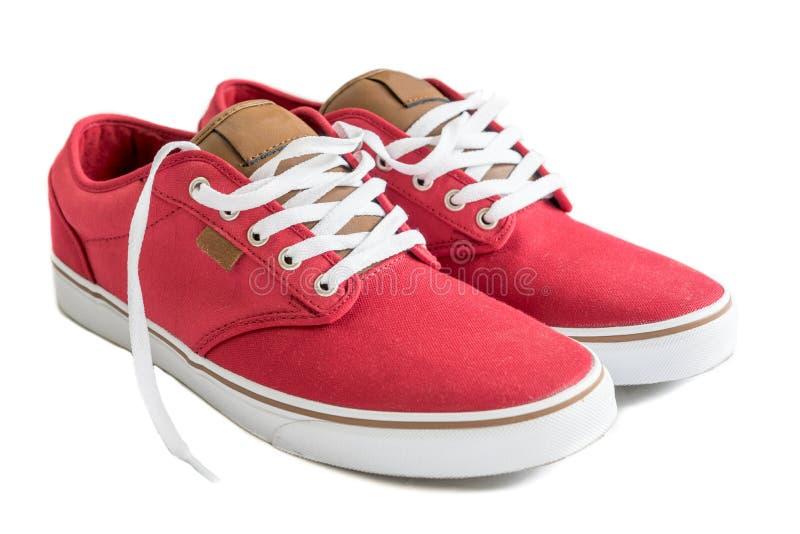查出的红色运动鞋 图库摄影