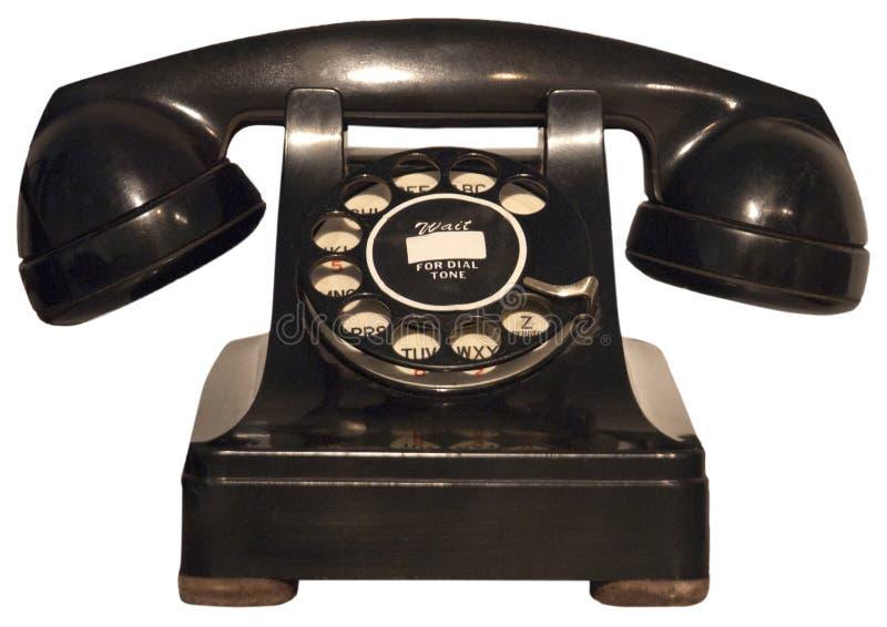 查出的老电话减速火箭的转台式电话葡萄酒 免版税库存照片