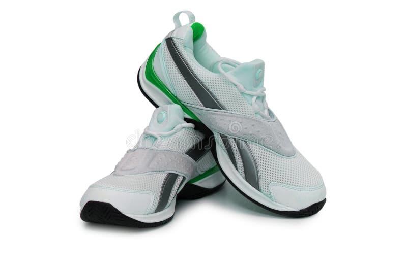 查出的背景穿上鞋子体育运动白色 免版税图库摄影