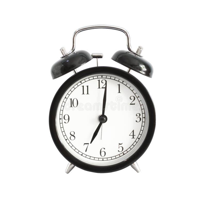 查出的闹钟 在下午7点上午或的闹钟设置 免版税图库摄影