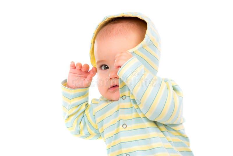 查出空白的一点的婴孩背景 婴孩掩藏他的fac 免版税库存图片