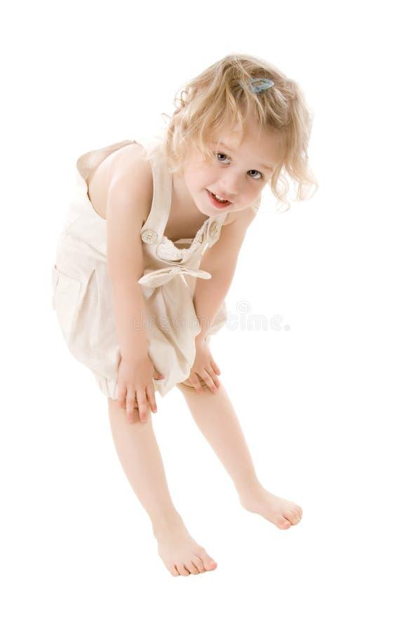 查出突出的一点的女孩愉快空白 免版税库存照片