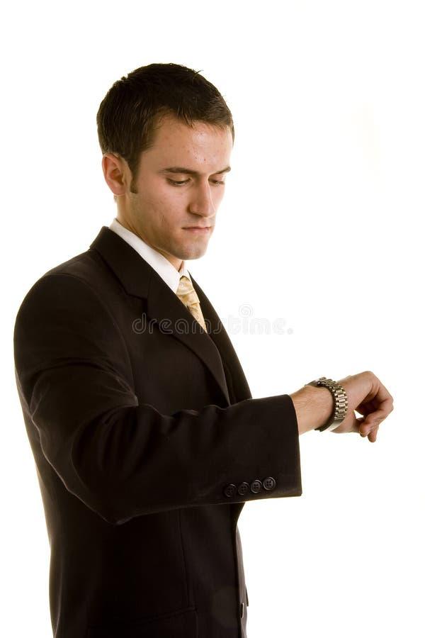 查找人严重的手表年轻人 库存照片