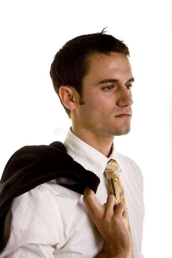 查找人严重的肩膀年轻人的夹克 免版税库存图片