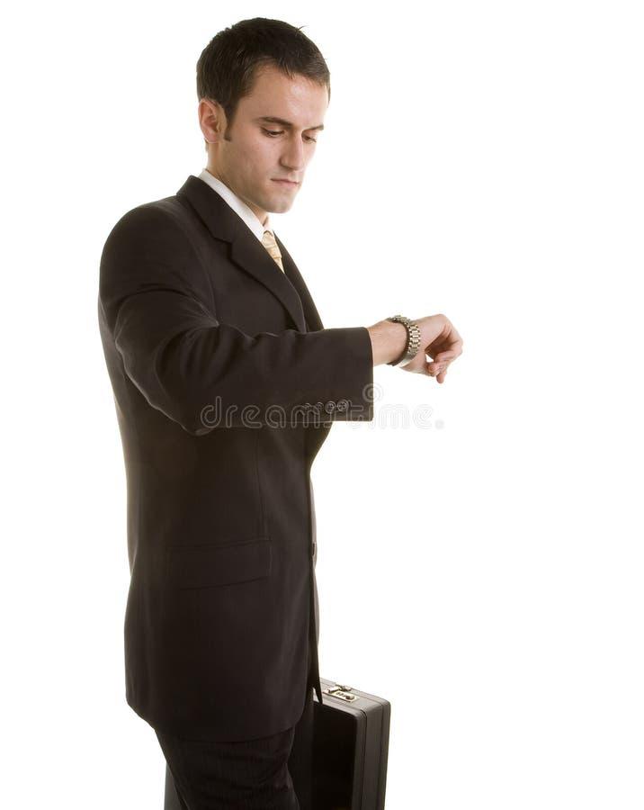 查找人诉讼手表年轻人的公文包 库存照片