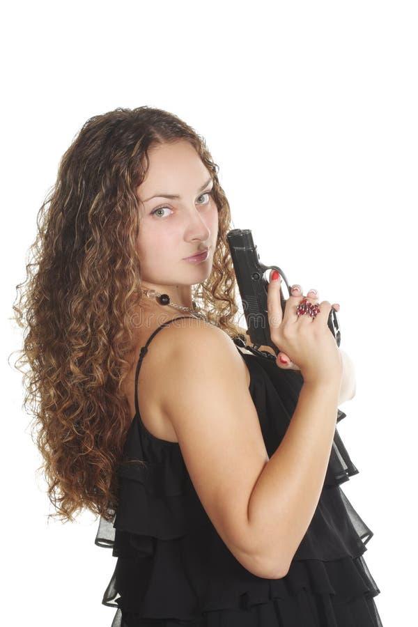 查找在严重的肩膀妇女的枪 免版税库存照片