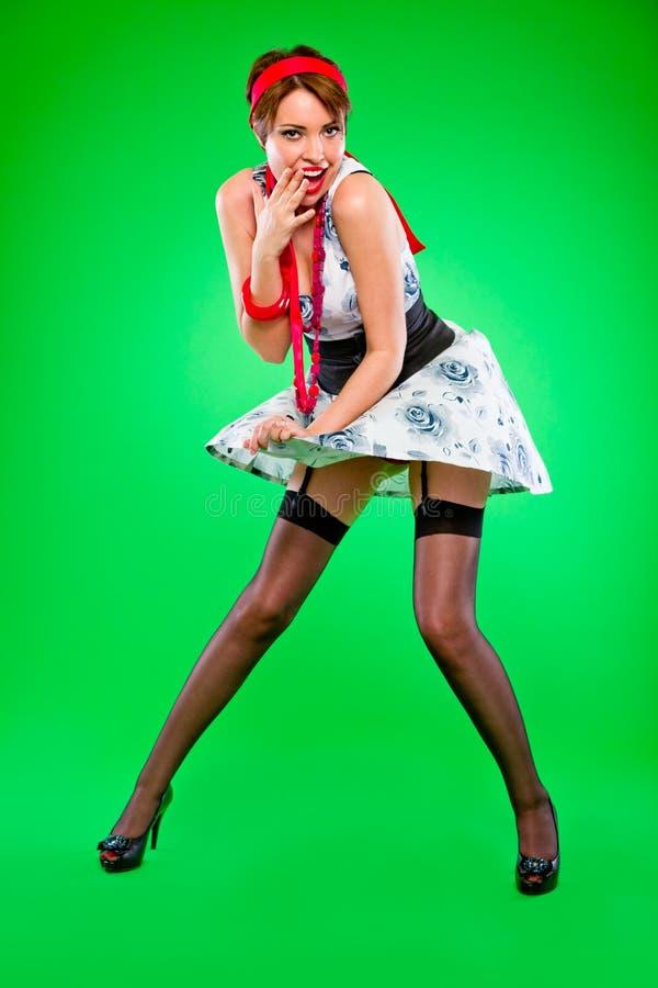 查找女孩藏品礼服的Flirty炸毁由风 库存图片