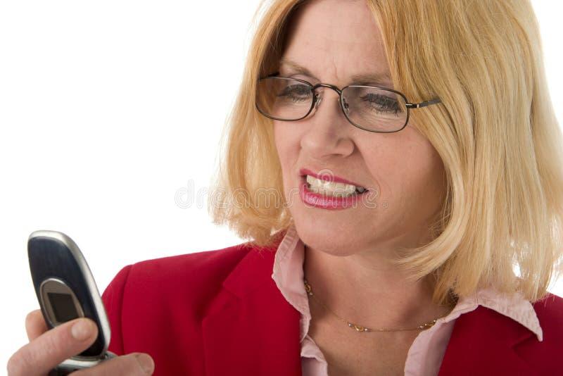 查找妇女的移动电话 免版税图库摄影
