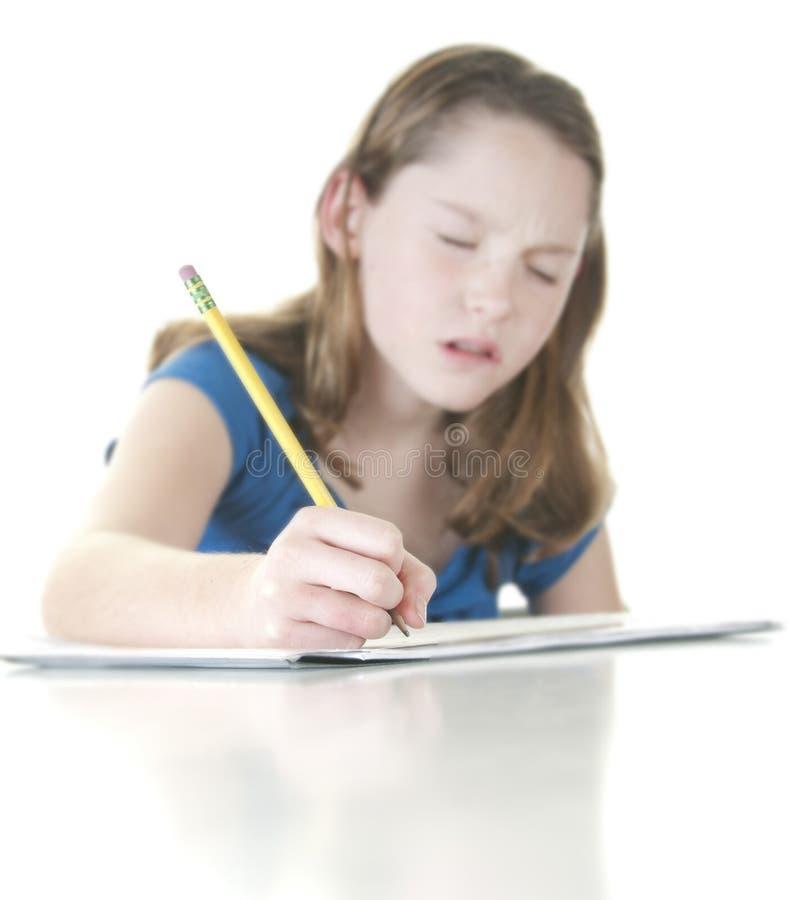 查找学校强调的工作年轻人的女孩 免版税库存照片