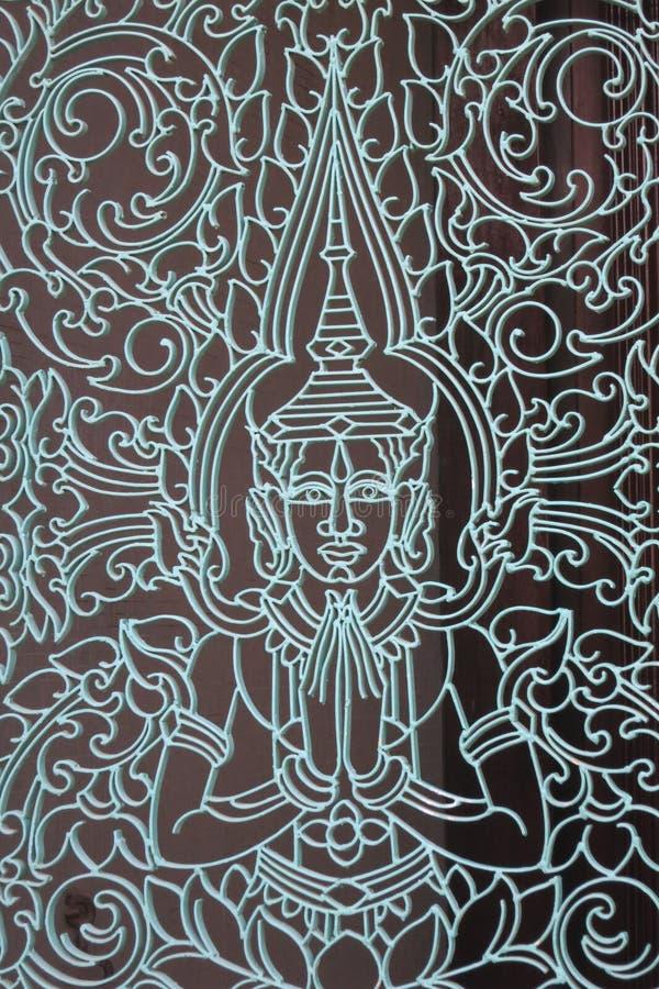 柬埔寨铁器和神在Pnomh Penh寺庙 库存图片