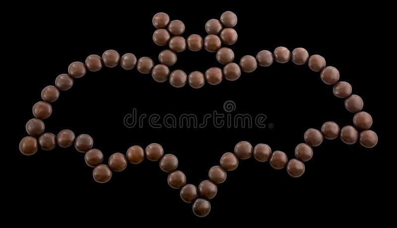 标志万圣夜-棒 等高由巧克力糖制成 图库摄影