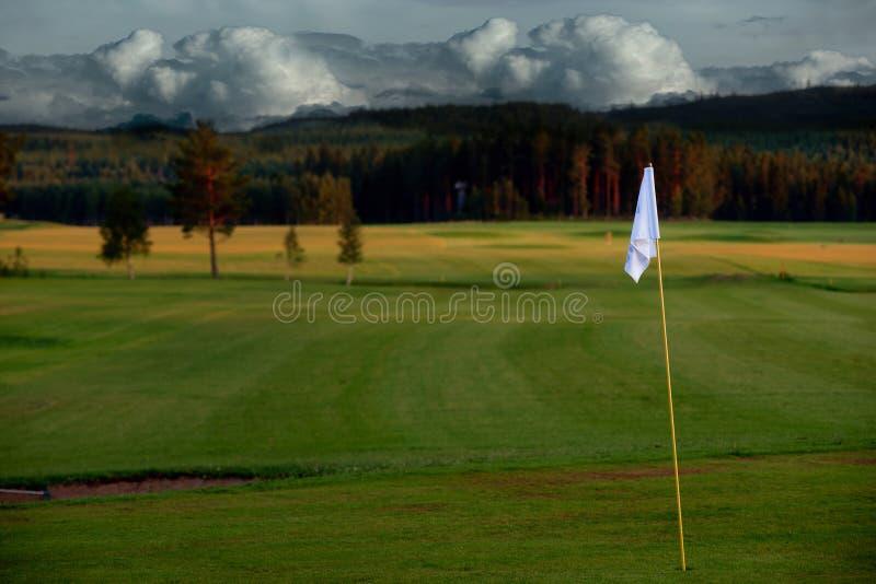 标志高尔夫球日落 免版税库存图片
