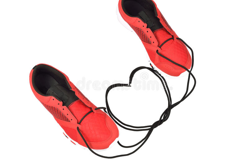 栓鞋带的运动鞋对心脏形状 免版税库存照片