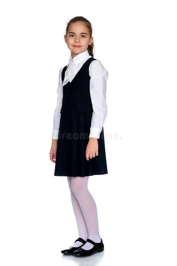 校服的美丽的小女孩 免版税库存照片
