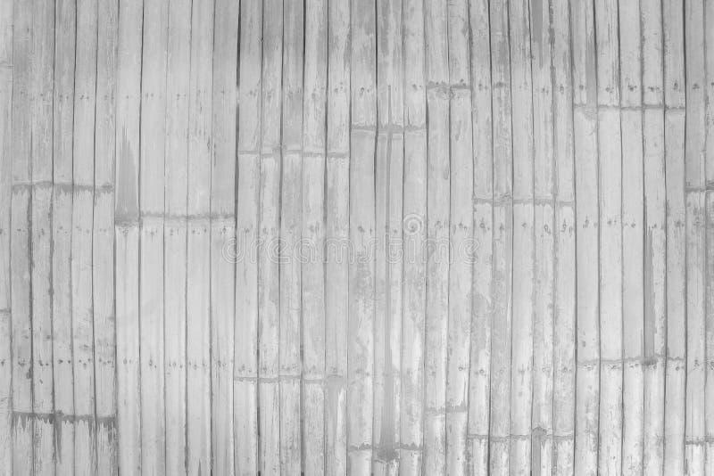 样式的泰国传统手工造老竹篱芭,自然木纹理背景 图库摄影