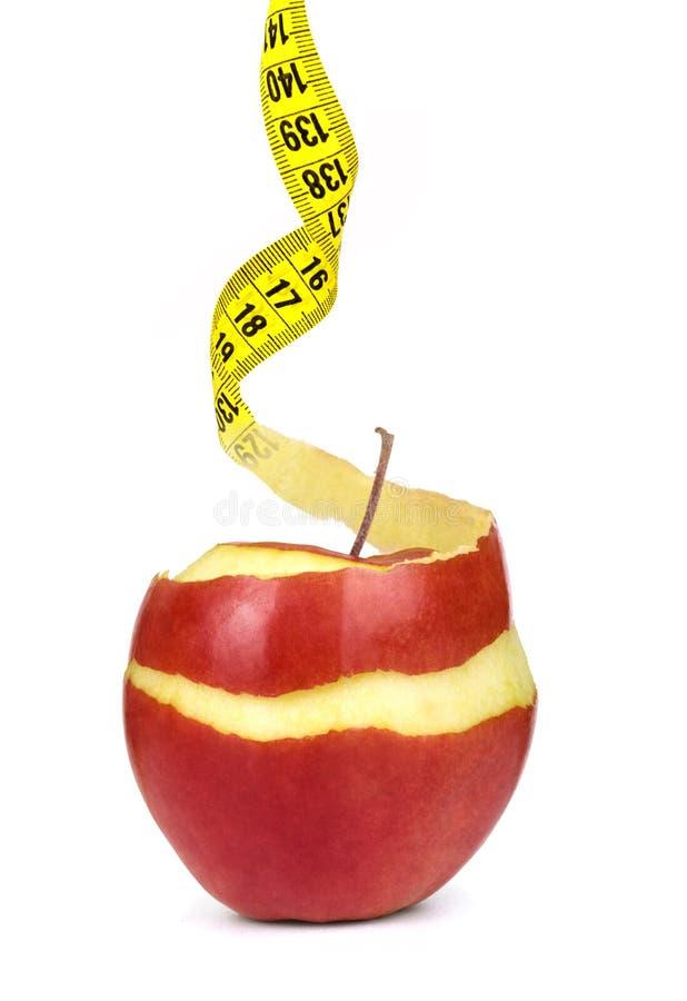 格兰尼史密斯苹果果皮把变成卷尺 库存图片