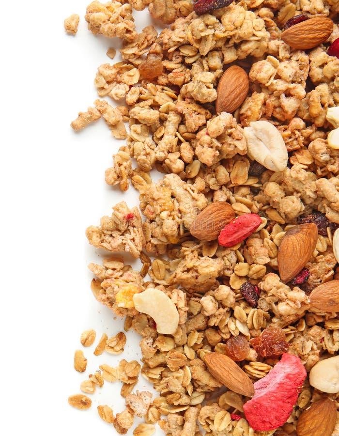 格兰诺拉麦片用干果子和坚果在白色背景 库存照片