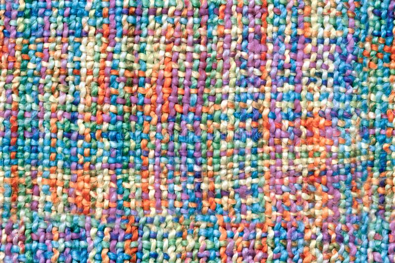 格子花呢披肩、毯子、地毯或者围巾的编织的明亮的五颜六色的羊毛无缝的啪答声 免版税库存图片