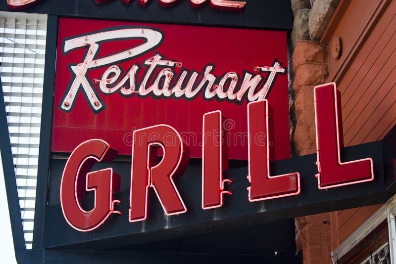 格栅霓虹餐馆符号 库存图片