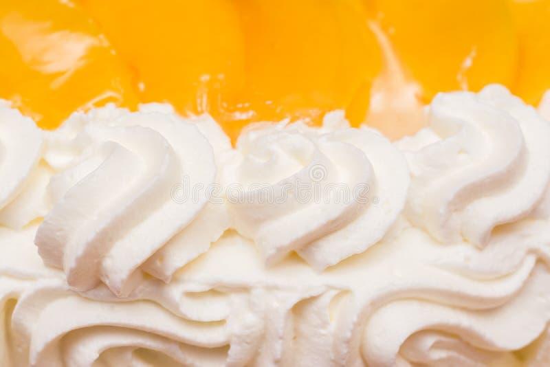 桃子鞭子奶油蛋糕 免版税库存照片