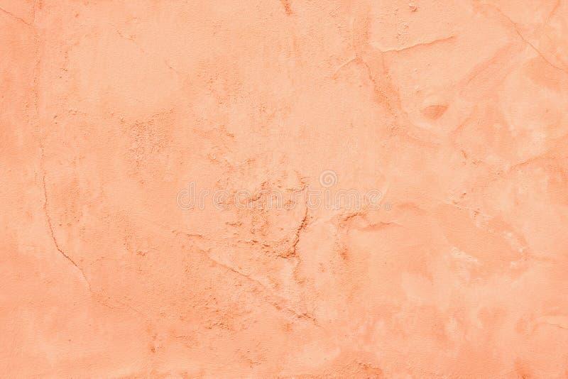 桃子颜色绘了老水泥膏药墙壁纹理 库存照片