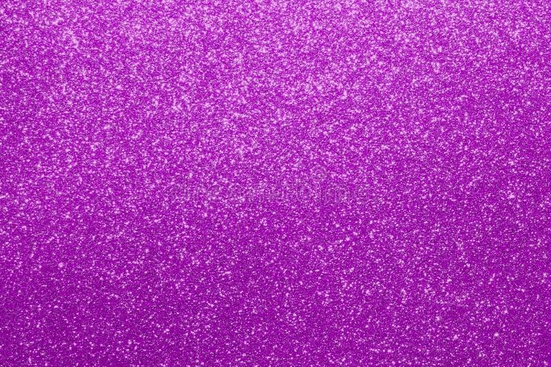 桃红色发光的金属沙子粒状表面-视觉导线概念纹理-相当抽象照片背景 库存图片