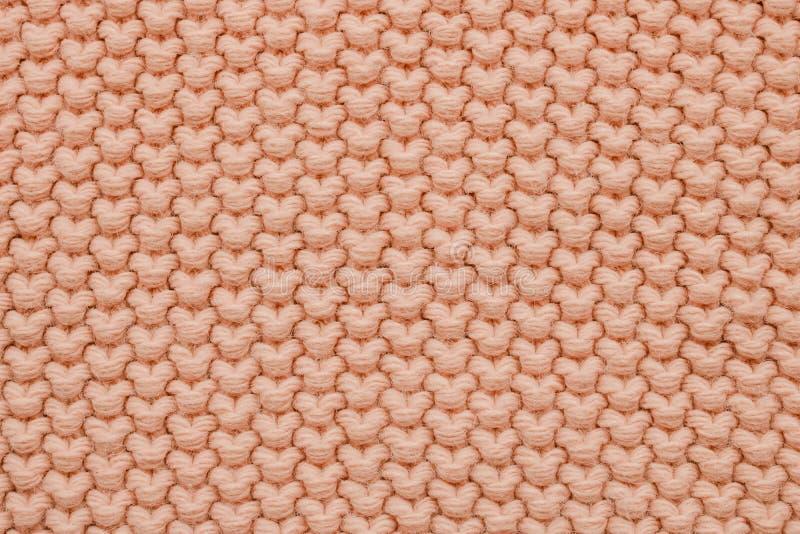 桃红色大羊毛编织纹理  r 免版税库存图片