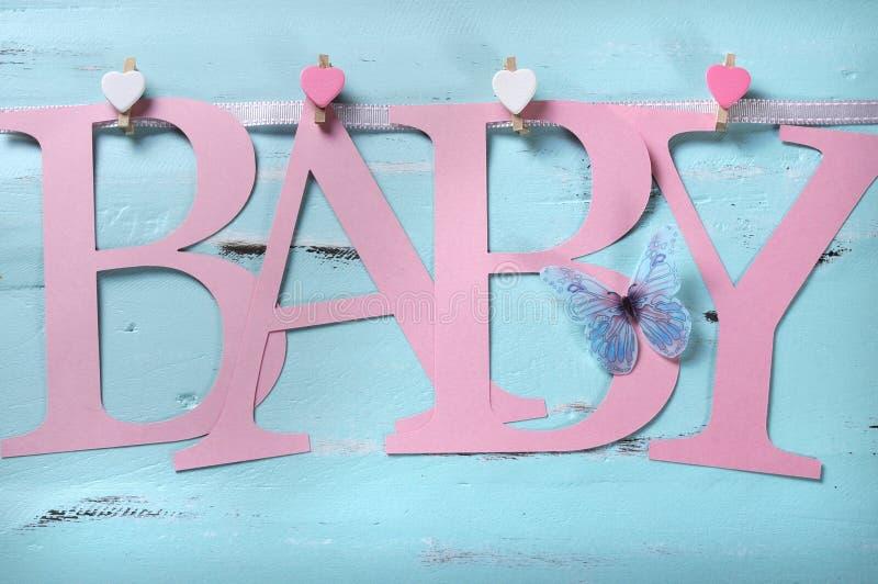 桃红色女婴托儿所在旗布上写字 免版税库存图片
