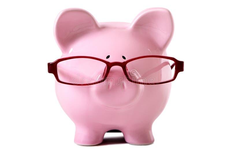 桃红色存钱罐佩带的玻璃 免版税库存照片
