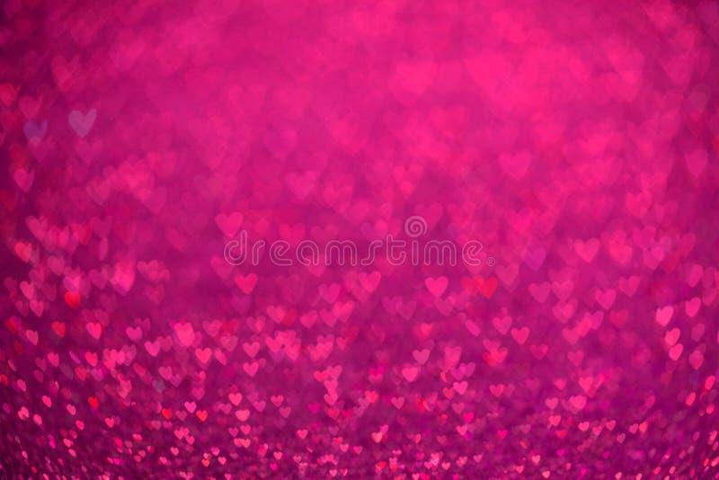 桃红色心脏bokeh背景 情人节纹理 免版税库存照片