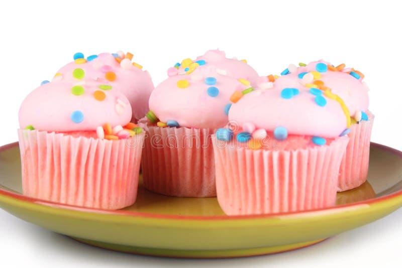 桃红色杯形蛋糕 免版税库存照片