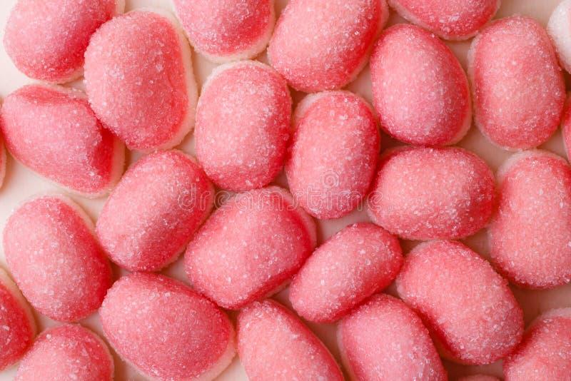 桃红色果冻或蛋白软糖作为背景 库存图片