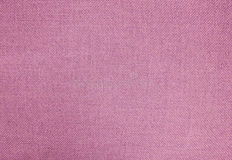 桃红色棉纺织品纹理淡色背景  免版税库存图片
