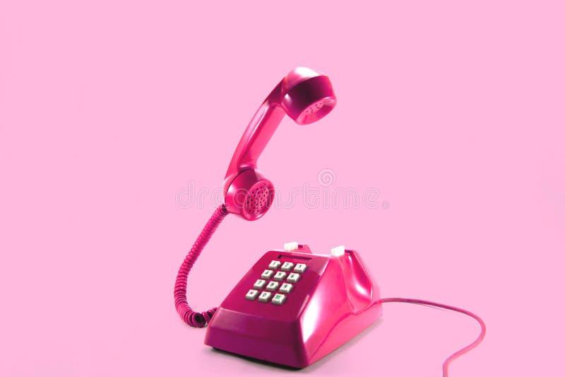 桃红色电话 图库摄影