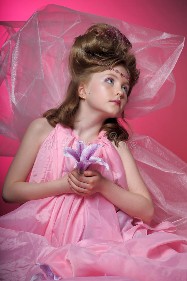 桃红色的女孩 免版税库存照片