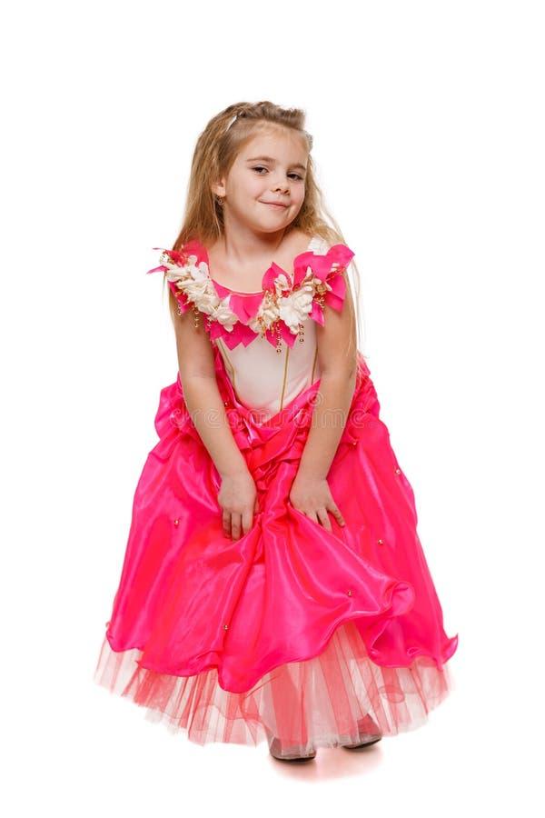 桃红色礼服的挥动的小女孩 库存照片