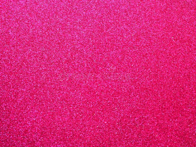 桃红色织品背景,发光的纹理 免版税库存图片