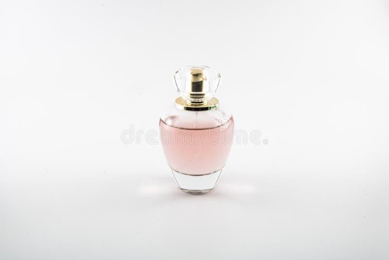 桃红色色的parfum 它在演播室被采取了 免版税库存图片