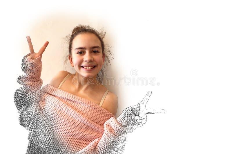 桃红色被编织的毛线衣的十几岁的女孩 库存图片