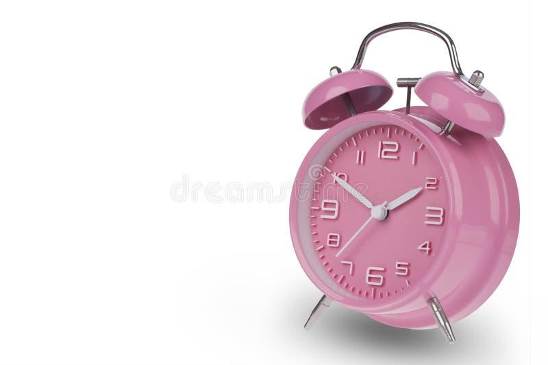 桃红色闹钟用在10和2的手 免版税库存图片