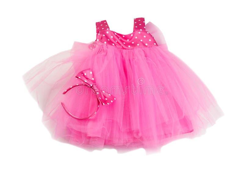 桃红色鞋带婴孩礼服 在白色的孤立 库存照片