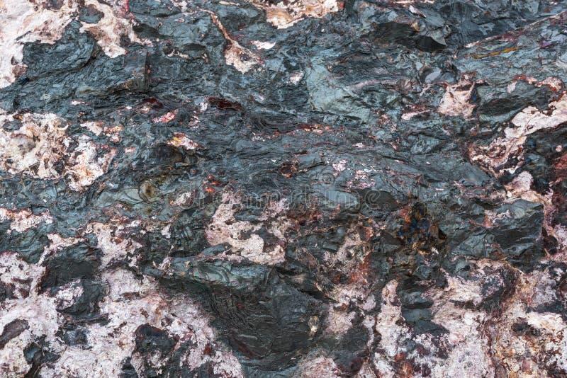 桃红色黑石头纹理  库存照片