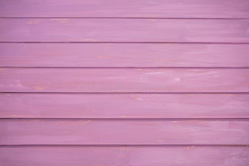 桃红色/紫色真正的木纹理背景 库存图片