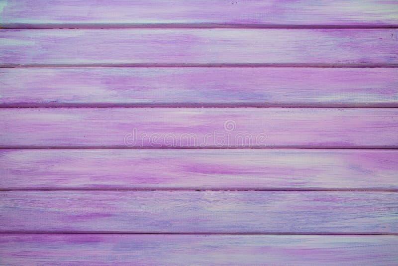 桃红色/紫色真正的木纹理背景 免版税库存图片
