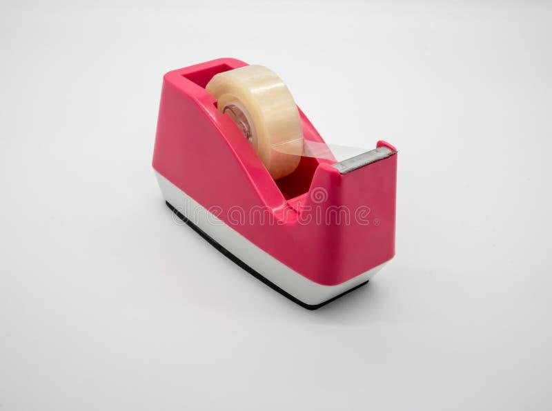 桃红色Sellotape在白色隔绝的透明胶带分配器 免版税库存照片