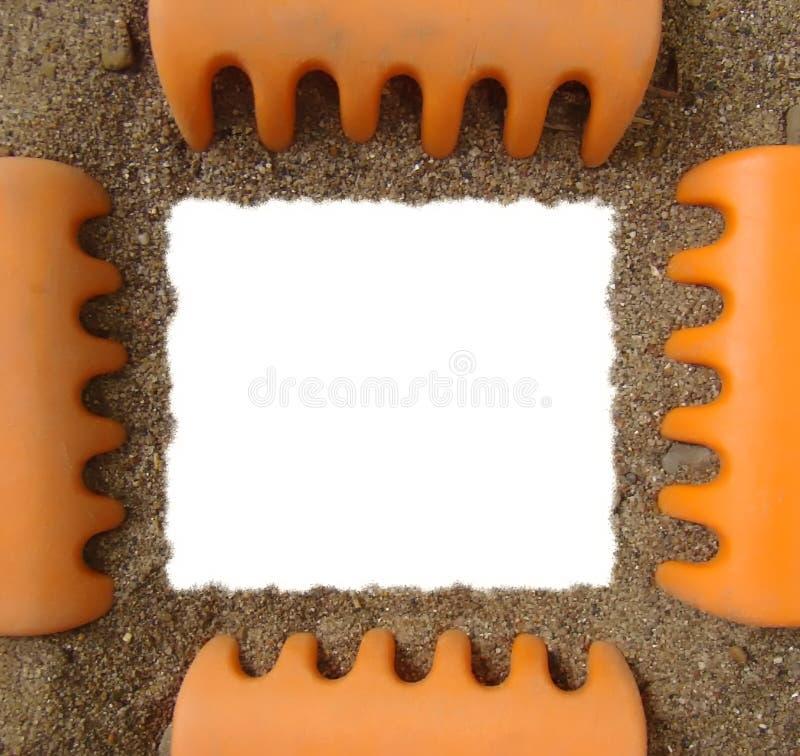 框架照片犁耙沙子玩具 免版税库存照片
