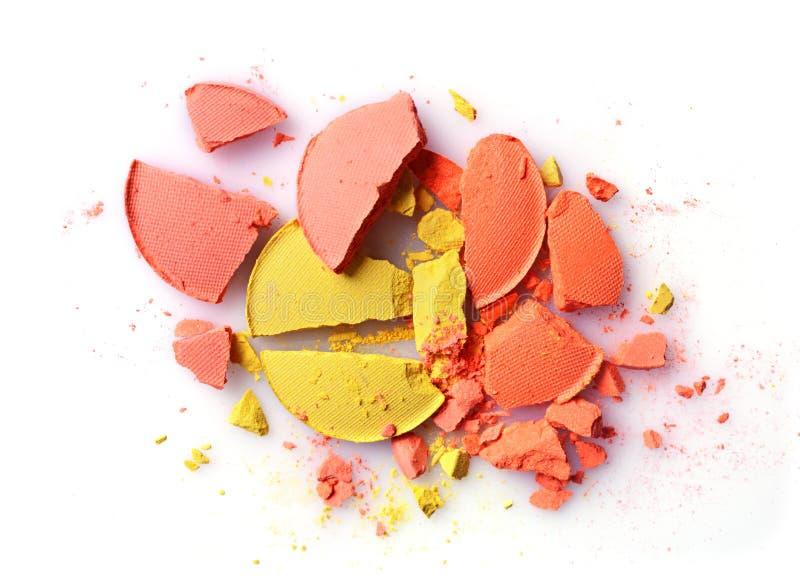 桔子和黄色碰撞了构成的眼影膏作为化妆产品样品  免版税库存照片