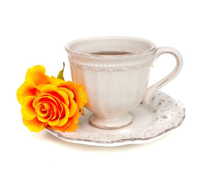 桔子玫瑰色和白色杯子 免版税库存照片