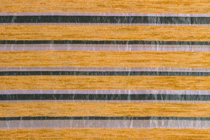 桔子镶边了综合性被编织的室内装璜织品特写镜头纹理 库存照片